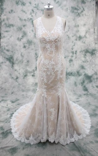 Champagne color underneath ivory lace overley mermaid bridal gown