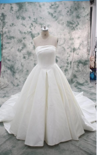 Plain satin ivory wedding dress with long train